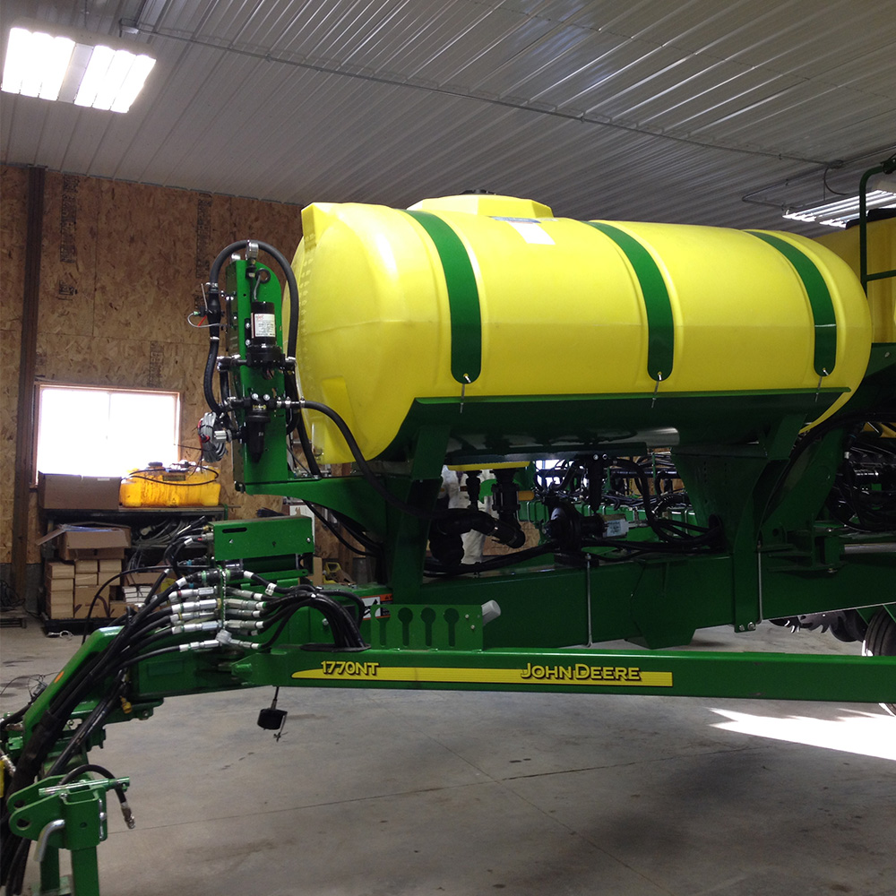 GX2 mounted in front of tank on JD